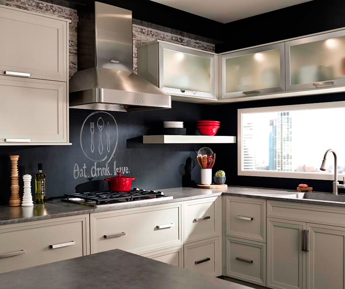 Grey cabinets in casual kitchen by Kitchen Craft Cabinetry