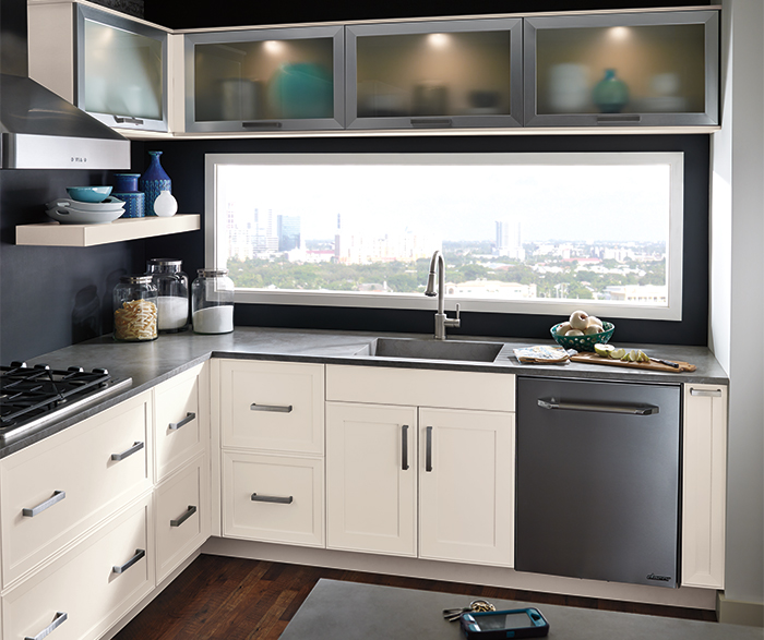 Off white kitchen cabinets by Kitchen Craft Cabinetry